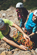 Rab climbing athletes enjoying a multipitches climbing trip at Los Mallos de Riglos, Spain