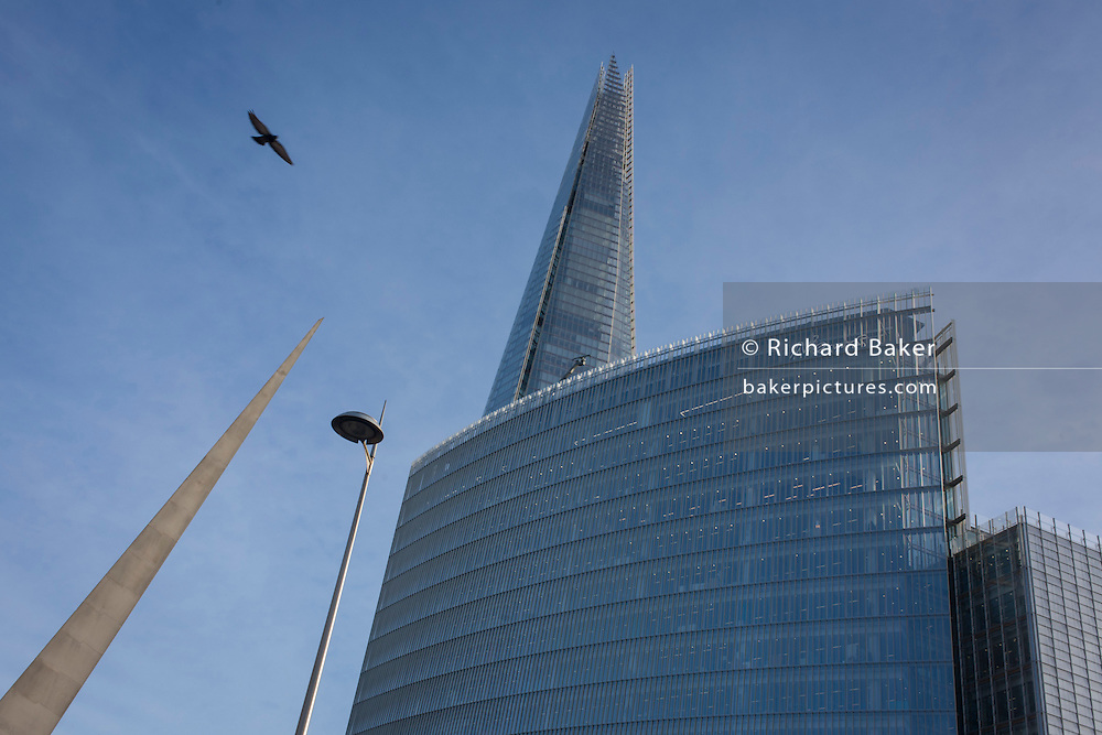 The Shard rises high above the News Building at London Bridge. The News Building is a 17-storey office block forming part of the London Bridge Quarter development. It houses all of News UK's London operations, including The Wall Street Journal, Dow Jones, The Times, The Sunday Times, The Sun and HarperCollins. It was designed by the Italian architect Renzo Piano, who also designed The Shard across the road from it, and was financed by Qatar, which is behind the London Bridge Quarter development.