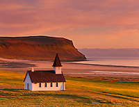 Church facing the midnight sun at Breidavík,  Látrabjarg Peninsula of the Westfjords Iceland, Europe