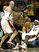 Washington Wizards center Brendan Haywood (C) tries to break free from a double team defense by Cleveland Cavaliers center Zydrunas Ilgauskas (L) and teammate LeBron James (R) during the third quarter of their game at the Quicken Loans Arena in Cleveland, Ohio, USA, 19 April 2008. The Cavaliers beat the Wizards 93-86 during the first game of the NBA Eastern Conference playoffs.