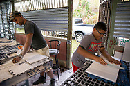 SAN LORENZO, PUERTO RICO - OCTOBER 9, 2017 -  Architect and furniture designer Luis Miranda and son construct PVC washing boards at his workshop in San Lorenzo, Puerto Rico, where the center of Hurricane Maria made most of the extensive damage. Miranda was forced to change the skope of his businees out of necessity. (Photo/Jos&eacute; Jim&eacute;nez) Through the Iris of Hurricane Mar&iacute;a<br />