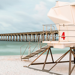 Pensacola Beach Pier and lifeguard tower four panorama photo. Pensacola Beach is on Santa Rosa Island in the Southeastern United States of America. Panoramic photo ratio is 1:3. Copyright ⓒ 2018 Paul Velgos with All Rights Reserved.