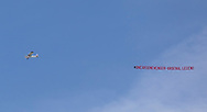 A banner is flown over the stadium to thank Arsene Wenger for his time at Arsenal during the Premier League match at the John Smiths Stadium, Huddersfield<br /> Picture by James Wilson/Focus Images Ltd 07522 978714<br /> 13/05/2018