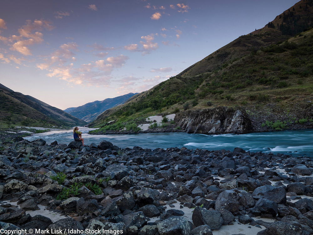 A rafter takes time to enjoy the morning sunrise along the lower Salmon River.