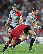 Sonny Bill Williams looks for support out wide after being caught in the tackle of Ben Daley ~ Super 15 rugby (Round 15) - Reds v Crusaders played at Suncorp Stadium, Brisbane, Australia on Sunday 29th May 2011 ~ Photo : Steven Hight (AURA Images) / Photosport