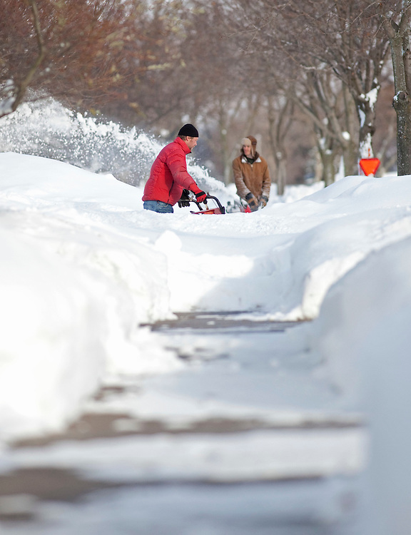 Residents of London, Ontario dig out December 8, 2010 following 3 days of heavy snow squalls which left some areas with over 1.5 metres of snow.<br /> The Canadian Press/GEOFF ROBINS