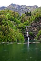 Ticino, Southern Switzerland. Green lake and waterfall in Ticino.