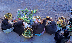 Blue , Colonial , Colors , Doorway , Friendly , Mexico , People , Smile , Town , Vertical , Village , Window , Women , color image Pile of vegetables at market, Mexico