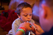 Seven-year-old Brandon Cooper, who was diagnosed in June with chronic myeloid leukemia, controls the amount of Gleevec he ingests as his father, Todd Cooper, dispenses the chemotherapy drug via oral syringe at home in Stuart on Thursday, Sept. 25, 2014. (Xavier Mascareñas/Treasure Coast Newspapers)