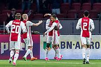 AMSTERDAM - 05-04-2017, Ajax - AZ, Stadion Arena, Ajax speler Bertrand Traore heeft de 1-0 gescoord, Ajax speler Justin Kluivert feliciteert hem.