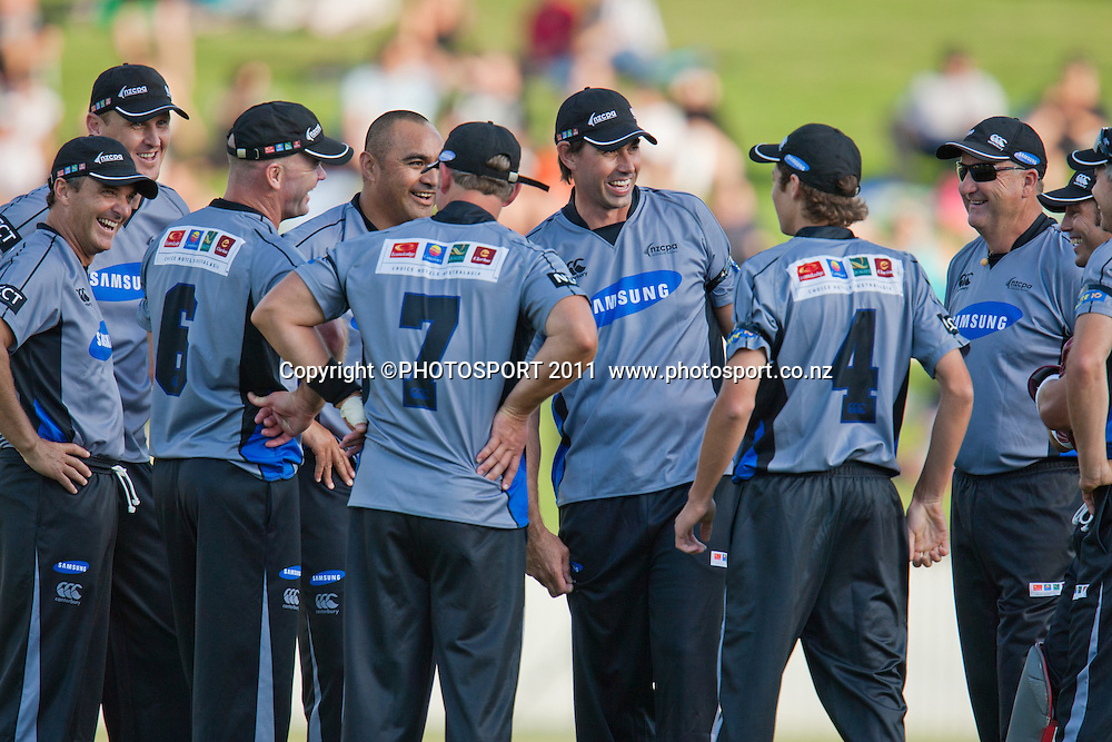Murphy Sua and Stephen Fleming and team celebrate Sua's dismissal of Chris Simpson during the Titans International Twenty20 Cricket, Samsung NZCPA Masters XI v Australia, Seddon Park, Hamilton, New Zealand, Thursday 24 February 2011. Photo: Stephen Barker/PHOTOSPORT