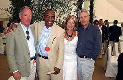 Left to right, MICHAEL BUERK, DARREN JORDAN, JENNIE BOND and NICHOLAS OWEN at the Cartier International polo at Guards Polo Club, Windsor Great Park, on 30th July 2006.<br />