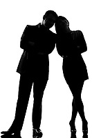 one caucasian couple man and woman standing face to face full length in studio silhouette isolated on white background