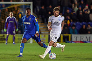 AFC Wimbledon defender Paul Kalambayi (30) battles for possession with Peterborough United attacker Matt (Matthew) Godden (9) during the EFL Sky Bet League 1 match between AFC Wimbledon and Peterborough United at the Cherry Red Records Stadium, Kingston, England on 12 March 2019.