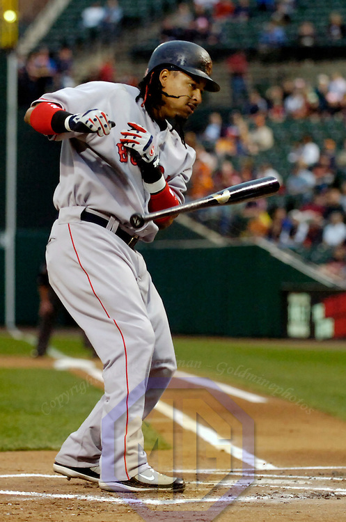 25 April 2007:   Boston Red Sox left fielder Manny Ramirez (24) throws his bat as he gets out of the way of an inside pitch in the first inning thrown by Baltimore Orioles pitcher Daniel Cabrera.  The Red Sox defeated the Orioles 6-1 at Camden Yards in Baltimore, MD.