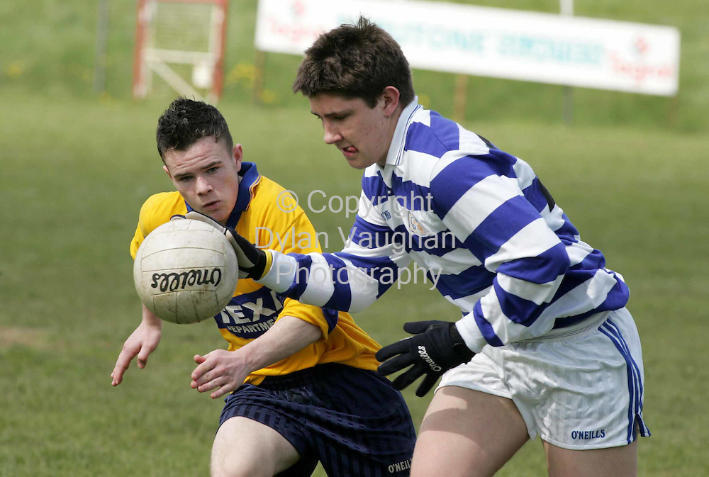 21/4/2005.Pictured in Action at the Colaiste Bhride, Carnew V Killina Pres. Sec School final in Athy was Killina's Scott Delaney (left) and Carnew's Dean Gordan..Picture Dylan Vaughan