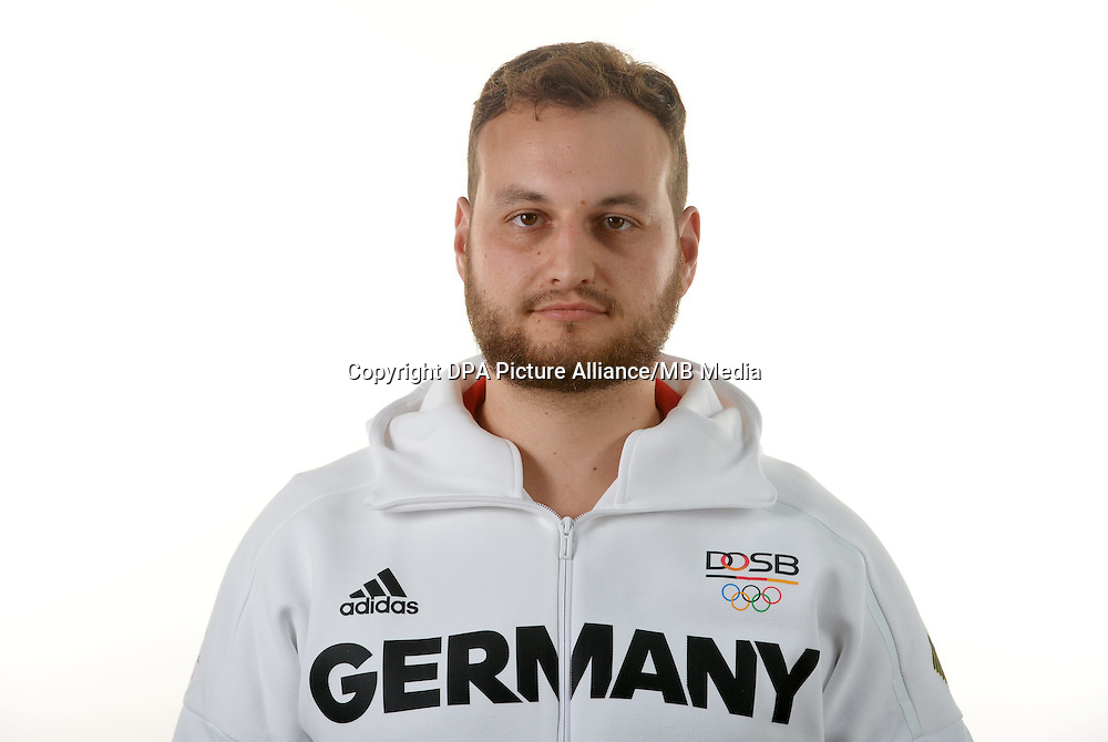 Daniel Brodmeier poses at a photocall during the preparations for the Olympic Games in Rio at the Emmich Cambrai Barracks in Hanover, Germany. July 07, 2016. Photo credit: Frank May/ picture alliance. | usage worldwide