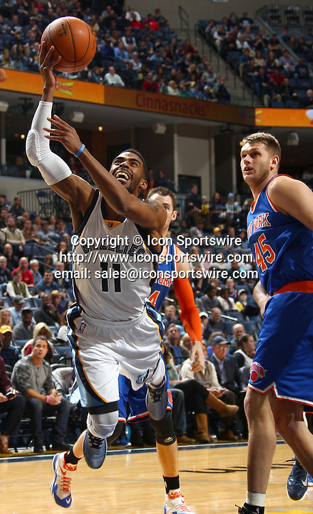 Jan. 5, 2015 - Memphis, TN, USA - Memphis Grizzlies' Mike Conley finishes his shot after being fouled by New York Knicks' Cole Aldrich on Monday, Jan. 5, 2015, at FedExForum in Memphis, Tenn