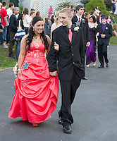 "Emmily Morin escorted by Tommy Phillips during the grand march at Meadowbrook for Laconia High Schools ""Grammy"" themed prom Friday evening.  (Karen Bobotas/for the Laconia Daily Sun)"
