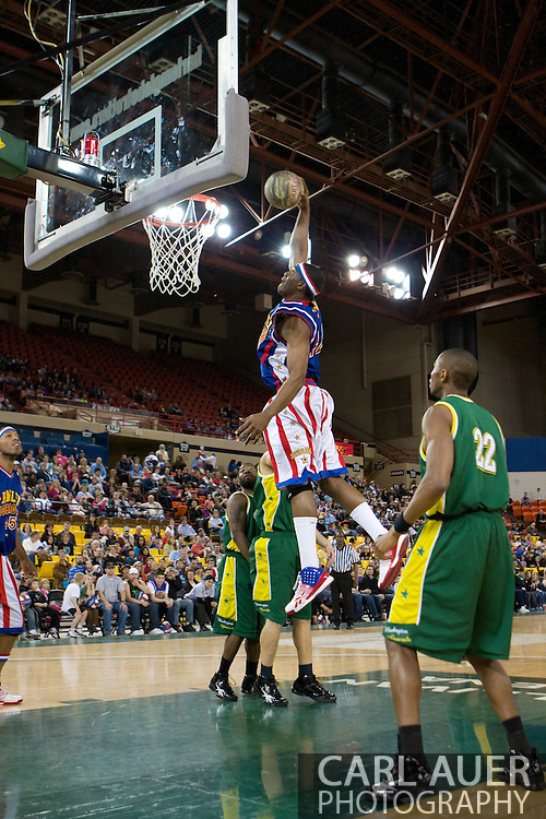 April 30th, 2010 - Anchorage, Alaska:  Harlem Globetrotter Titan (42) thrills the crowd as he flies through the Washington Generals fully extended for a thundering one handed slam dunk.