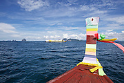 Thailand, Ko Kradan. Leaving the island with longtail boat and ferry.