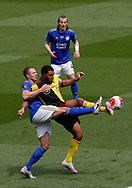 Jonny Evans of Leicester City challenges Troy Deeney of Watford during the Premier League match at Vicarage Road, Watford. Picture date: 20th June 2020. Picture credit should read: Darren Staples/Sportimage
