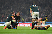 New Zealand hooker Keven Mealamu consoles South Africa number eight Duane Vermeulen and South Africa players are dejected after the final whistle of the Rugby World Cup Semi-Final match between South Africa and New Zealand at Twickenham, Richmond, United Kingdom on 24 October 2015. Photo by David Charbit.