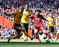 Football - 2018 / 2019 Premier League - Liverpool vs. Wolverhampton Wanderers <br /> <br /> Mohamed Salah of Liverpool vies with Ryan Bennett of Wolverhampton Wanderers , at Anfield<br /> <br /> COLORSPORT/BRUCE WHITE