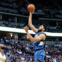 15 February 2017: Minnesota Timberwolves center Karl-Anthony Towns (32) goes for the baby hook over Denver Nuggets guard Will Barton (5) during the Minnesota Timberwolves 112-99 victory over the Denver Nuggets, at the Pepsi Center, Denver, Colorado, USA.