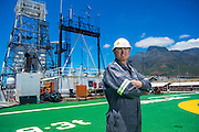 GAC Employee standing on the Helipad on the Coral Sea