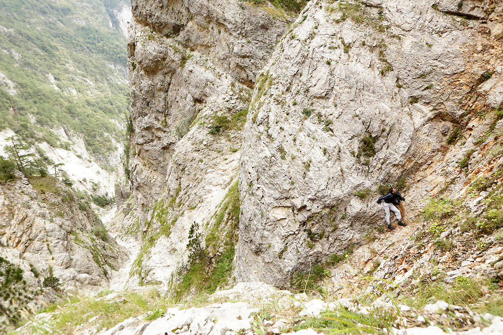 A stranded hiker during a rescue mission, Veliki Kuk, Čvrsnica mountain, Bosnia and Herzegovina.  The uninjured hiker was found standing on a very small ledge in a narrow couloir, unable to move in any direction due to its perilous position.
