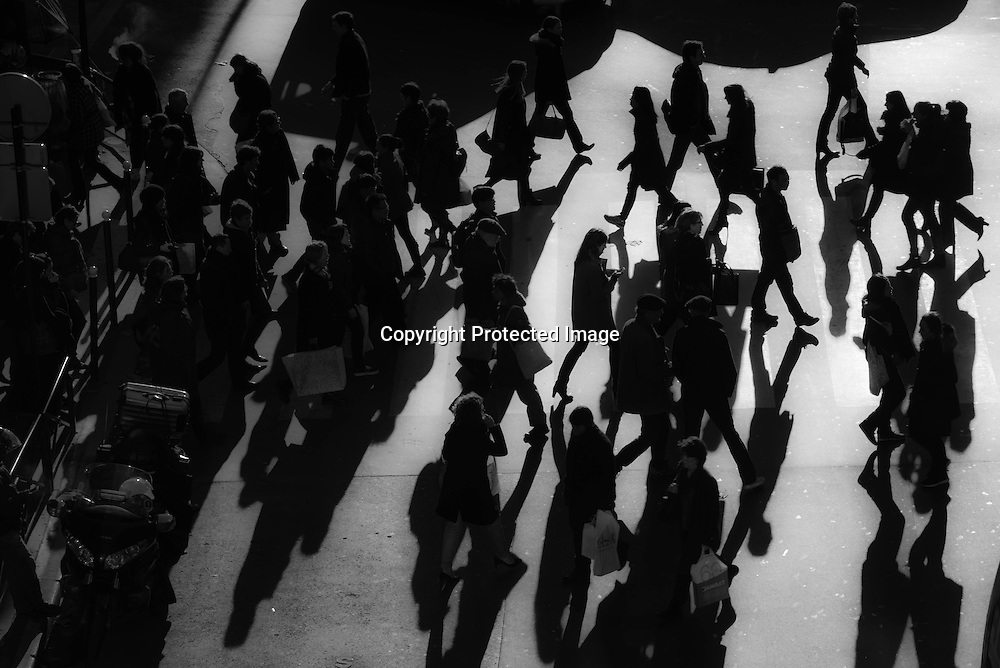 Paris. elevated view on pedestrians crossing a street in winter light / pietons traversant une rue , vu d'en haut