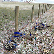 discarded scooters lye in a field in Pennsylvania by Amish children who use them as a form of transport. Bicycles and cars etc are banned by the Amish.
