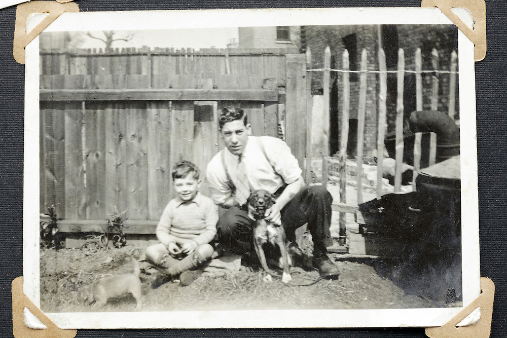father and son with dog and cat posing for an image