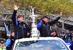 "Helmsman Peter Burling, left and CEO Grant Dalton with the Americas Cup as the Emirates Team New Zealand welcome home parade heads downtown, Auckland, New Zealand, Thursday, July 06, 2017. Credit: SNPA / Marty Melville  ""NO ARCHIVING"""