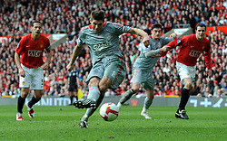 Steven Gerrard scores the second goal from the penalty spot during the Barclays Premier League match between Manchester United and Liverpool at Old Trafford on March 14, 2009 in Manchester, England.