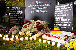 © Licensed to London News Pictures. 21/11/2016. Birmingham, UK. A service of prayer to mark the deaths of 21 people killed in the Birmingham Pub bombings on the 42nd anniversary. Pictured, flowers and candles outside the Cathedral. credit: Dave Warren/LNP