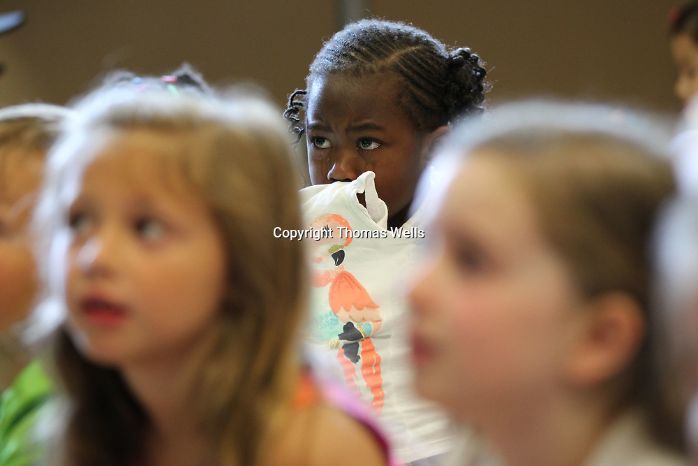 Maliyah Patton fights back more tears as she doesn't like her first introduction to kindgarten at Joyner Elementary School on Wednesday,