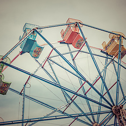 Ferris Wheel vintage photo in Newport Beach California. The Ferris Wheel is in the Balboa Fun Zone amusement park on Balboa Peninsula in Newport Beach, Orange County, California. The ferris wheel is a popular Southern California attraction and has provided childhood memories for generations. The photo was taken in 2010 and has a vintage 1970's tone applied.