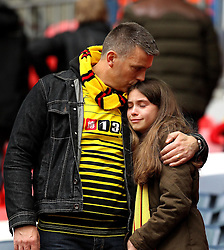 A Watford fan is consoled after seeing her side lose in the FA Cup Semi-Final to Crystal Palace - Mandatory by-line: Robbie Stephenson/JMP - 24/04/2016 - FOOTBALL - Wembley Stadium - London, England - Crystal Palace v Watford - The Emirates FA Cup Semi-Final