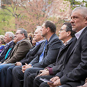 Monacan Chief, Dean Branham, right, listens as Virginia Governor Ralph Northam speaks during the dedication ceremony for Mantle: Virginia Indian Tribute, a monument designed on Virginia State Capitol Square, in Richmond, Virginia, on Tuesday, April 17, 2018. John Boal Photography