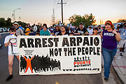 "23 JUNE 2012 - PHOENIX, AZ:  Children carry a banner around the Maricopa County Jail Saturday. About 2,000 members of the Unitarian Universalist Church, in Phoenix for their national convention, picketed the entrances to the Maricopa County Jail and ""Tent City"" Saturday night. They were opposed to the treatment of prisoners in the jail, many of whom are not convicted and are awaiting trial, and Maricopa County Sheriff Joe Arpaio's stand on illegal immigration. The protesters carried candles and sang hymns.     PHOTO BY JACK KURTZ"