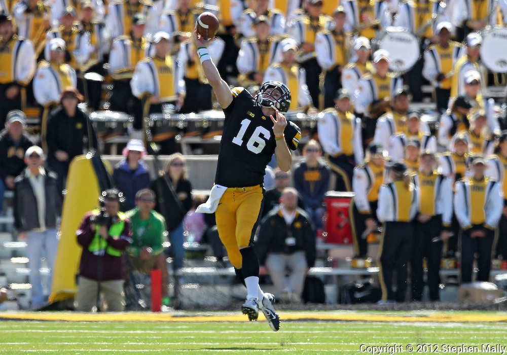 September 22 2012: Iowa Hawkeyes quarterback James Vandenberg (16) throws the ball during the second half of the NCAA football game between the Central Michigan Chippewas and the Iowa Hawkeyes at Kinnick Stadium in Iowa City, Iowa on Saturday September 22, 2012. Central Michigan defeated Iowa 32-31.