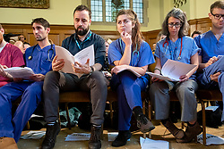 © Licensed to London News Pictures. 27/11/2019. London, UK. NHS doctors look at copies of an unredacted  report on trade negotiations with the United States that allegedly affects the NHS at a Labour Party event in Westminster. Photo credit: Rob Pinney/LNP