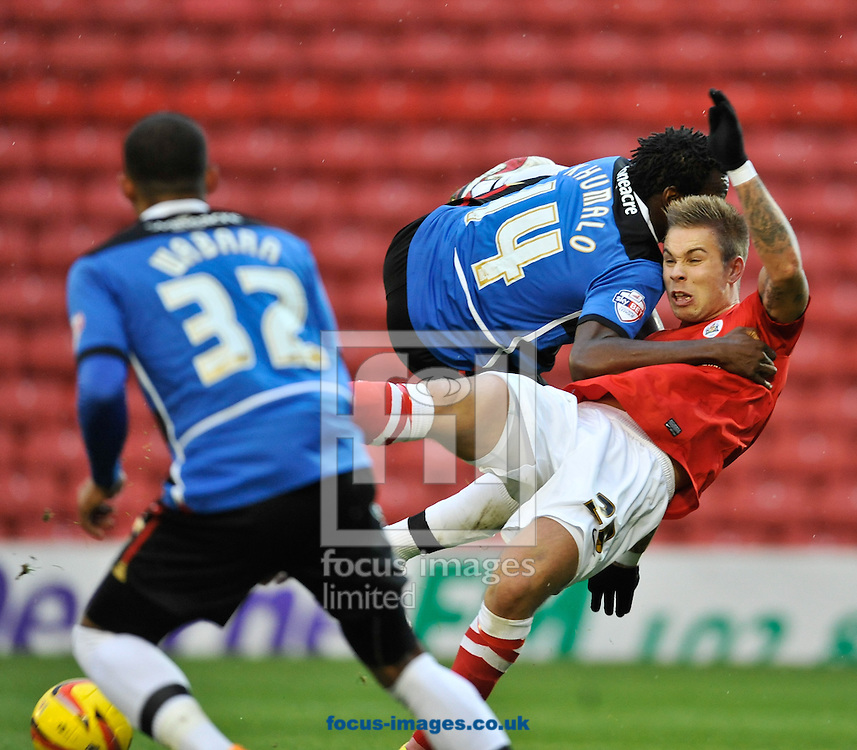 Picture by Richard Land/Focus Images Ltd +44 7713 507003<br /> 09/11/2013<br /> Marcus Pederson of Barnsley is brought down for a penalty by Bongani Khumalo of Doncaster Rovers during the Sky Bet Championship match at Oakwell, Barnsley.
