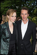 EDIE CAMPBELL; OTIS FERRY, 2014 Serpentine's summer party sponsored by Brioni.with a pavilion designed this year by Chilean architect Smiljan Radic  Kensington Gdns. London. 1July 2014