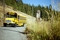 A Coeur d'Alene School District bus waits for parents to meet students at the intersection of Alder Creek and Wolf Lodge Creek roads after school Thursday.