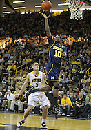 February 19 2011: Michigan Wolverines guard Tim Hardaway Jr. (10) puts up a shot as Iowa Hawkeyes guard Matt Gatens (5) looks on during the second half of an NCAA college basketball game at Carver-Hawkeye Arena in Iowa City, Iowa on February 19, 2011. Michigan defeated Iowa 75-72 in overtime.