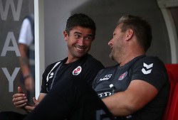 Crawley Town manager Harry Kewell (left) and Charlton Athletic manager Karl Robinson talk prior to kick off