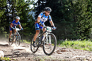 SHOT 8/19/11 9:13:55 AM - Lennie Moon of Birmingham, Alabama makes his way down a rocky section of trail while competing in the Solo 40 Men's category during the final day of racing in The Breck Epic in Breckenridge, Co. The event is a 6-day ultra-endurance mountain bike stage race held in the sprawling backcountry surrounding the town of Breckenridge, Co. The course is 240 miles and features a combined 38,000 feet of climbing, 90% of which is above 10,000 feet. More than 200 riders from 15 different countries participated in the race. (Photo by Marc Piscotty / © 2011)